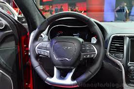 jeep grand cherokee srt red jeep grand cherokee srt red vapor steering wheel at the 2014 paris