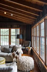 Modern Country Homes Interiors by Rustic Living Room By Timothy Johnson Design Muskoka Cottage