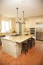 concrete countertops kitchen island with overhang lighting