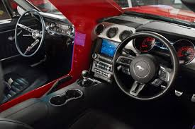 mustang 2015 inside ford shows 50 years of innovation in a combined 1965 2015 mustang