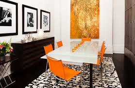 how to decorate with orange to stylishly warm up any room