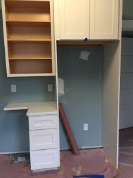 Installing Base Cabinets On Uneven Floor Trimming Out Base Cabinet On Unlevel Floor