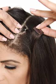 one hair extensions step 23 use one hair elastic and an extension weft with a single