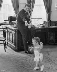 john f kennedy with 18 month old son john jr pictures getty images