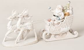 Christmas Reindeer And Sleigh Decorations by White Santas And Sleighs Christmas Tablescape Decor