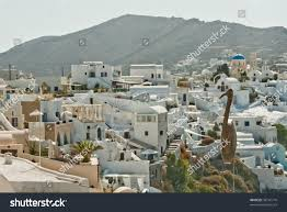 santorini greece whitewashed houses town on steep hillside
