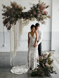 wedding backdrop modern understated elegance modern macramé matte black wedding