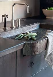 rustic modern kitchen features modern faucet and hammered stone