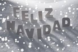 white feliz navidad means merry on snow snowflakes stock