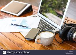 laptop tablet smartphone and coffee cup with financial