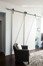 Erias Home Designs Top Of Door Sliding Barn Door Hardware by Single Track Bypassing Barn Door Hardware To Make A Den Into