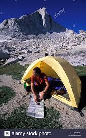 Sierra Nevada Mountains Map Man Looking At His Map Beside His Tent In Eastern Sierra Nevada
