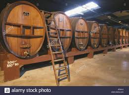 noilly prat vermouth barrels at noilly prat vermouth marseillan france stock photo