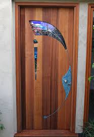 coloured glass door knobs stained glass and wood entry door by james hubbell artistic