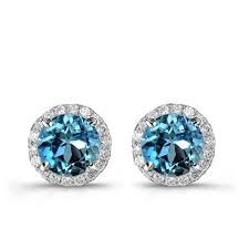 blue stud earrings white gold treated blue diamond stud earrings with white diamond halo