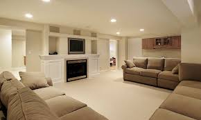 luminious living space basement remodel with cozy sofa facing big
