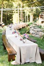 Backyard Engagement Party Decorations by Casual Backyard Biergarten Engagement Party Picnic Tables