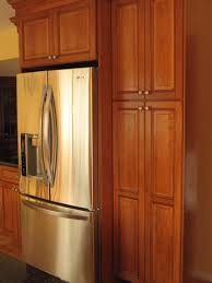 do you have a gap between the top of your frig and cabinet above
