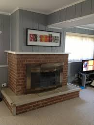 How To Update Brick Fireplace by How To Update This Dated Brick Fireplace