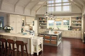 nice white farmhouse kitchen with large square kitchen island