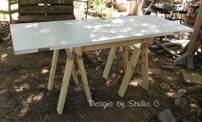 Diy Sawhorse Desk by How To Build A Sawhorse Table With Brackets U2013 Designs By Studio C