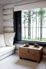paint the interior of a log cabin white to brighten it up around