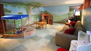 magical hillside child s playroom with adult spaces and tree mural like architecture interior design follow us