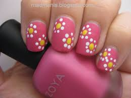 dotting nail art technique to create floral designs nail art