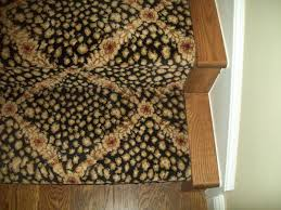 carpeted stairs with hardwood floors