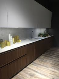 under cabinet led lighting puts the spotlight on the kitchen counter marble kitchen backsplash and countertop decorated with gold accessories and eye cathing led under cabinet lighting
