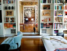 interesting decorative details on white bookshelves white