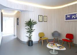 curved wood wall dublin dental practice by agency features curved wooden walls