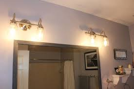 bronze bathroom light fixtures white concreat sink pale marble