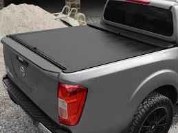 nissan np300 navara nissan np300 roll and lock tonneau cover 2016 on
