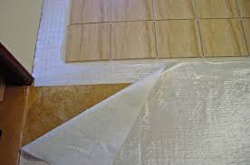 how to lay a floating porcelain or ceramic tile floor over a fiberglass mat