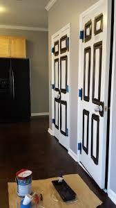 spray painting a door using graco airless spray gun or paint