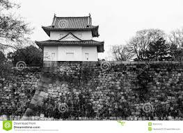 a big old stone wall and small castle of osaka castle stock
