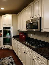brown granite countertops with white cabinets white cabinets with brown countertops davidarner com