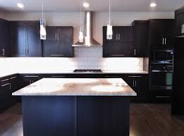 contemporary kitchen lighting fixtures white subway tiles and espresso cabinets with modern light