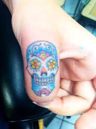 21 sugar skull tattoos design on finger