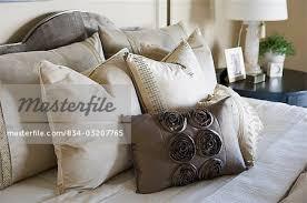 bedding throw pillows collection of throw pillows on bed stock photo masterfile