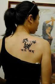 tribal horse n japanese words tattoo on back tattoos book