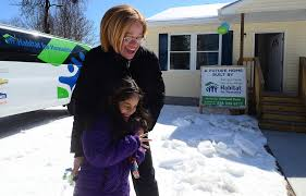 habitat for humanity dedicates home welcomes new family to