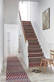 pretty stair carpet treads in staircase farmhouse with wall paint