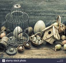 Home Interior Bird Cage Vintage Easter Decoration With Eggs Birdhouse And Birdcage Stock