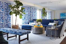accent living room tables blue living room with mirrored accent wall contemporary living room