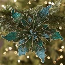 poinsettia clip ornament turquoise still working this tree