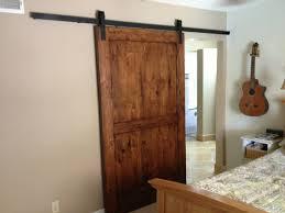 Interior Door Hanging Walnut Brown Alder Sliding Barn Door Hanging On Black Metal Rod