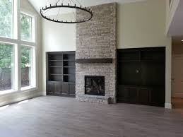 fireplace indoor fireplace stone to ceiling gas fireplace hearth mantle
