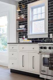 glossy black kitchen backsplash tiles that go all the way up to